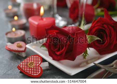 Cutlery for a romantic dinner on a gray background