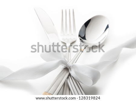 cutlery - knife, spoon and fork tied ribbon - stock photo