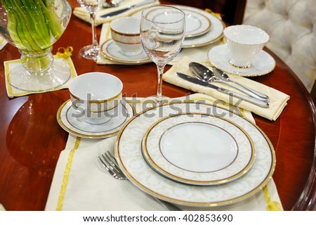 Cutlery on a dining table - stock photo