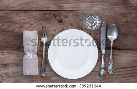 cutlery on a wooden table - stock photo