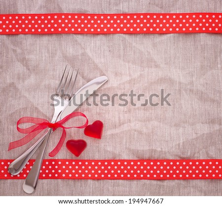 Cutlery on red checkered tablecloth tartan. Wooden table close up view from top. Wooden kitchen cutting board retro. Product pages for installation recipe books menu