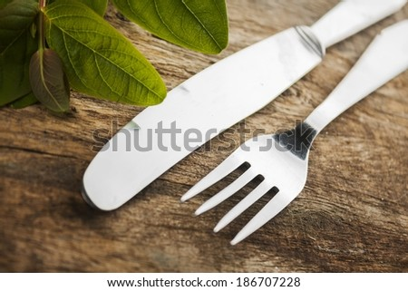 cutlery on rustic wooden background - stock photo