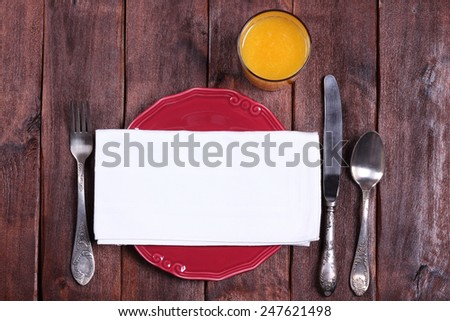 Cutlery on the table and empty plate with a napkin. White napkin on a plate. Place for an inscription, background. Restaurant, catering establishments, table. - stock photo