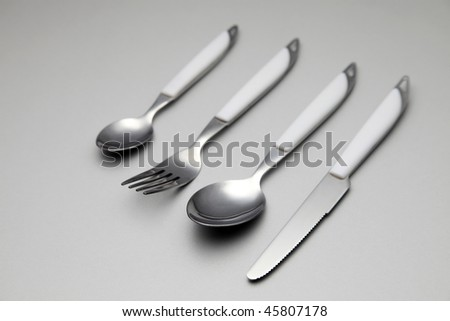 cutlery set on the plain color background