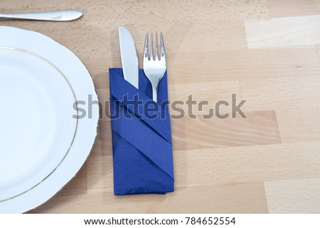 Cutlery with blue napkin