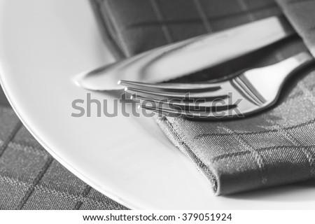 Cutlery with napkin.  Monotone. - stock photo