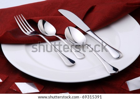 cutlery with red napkin - stock photo