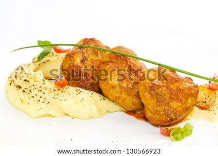 cutlets fried in carrot sauce with mashed potatoes