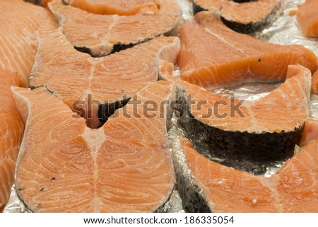 Cutlets of salmon. fish for sale in shop. fish chops. salmon background.