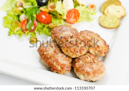Cutlets with vegetable salad
