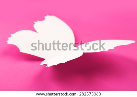 Cutout paper butterfly as greeting card - stock photo