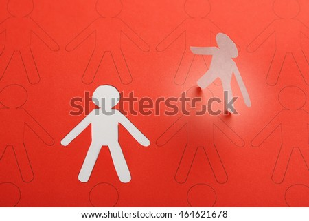 cutout paper person having been chosen among other candidates, business or social concept