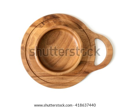 Cutout wooden bowl on a wooden chopping board. Top view. Wooden Tableware. Environmentally friendly goods. Durable material. Naturally beautiful goods. Strength material. Safe to use. - stock photo