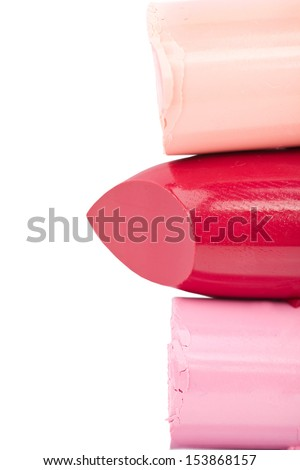 Cutted lipsticks closeup on white background