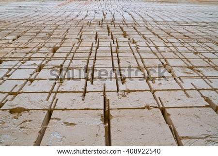 Cutted wall of the main pit of the Lithica quarry in Menorca, a sandstone block production place since prehistory. - stock photo