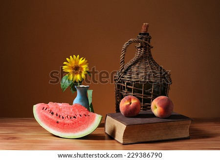 Cutted watermelon, sunflower blossom and peach - stock photo