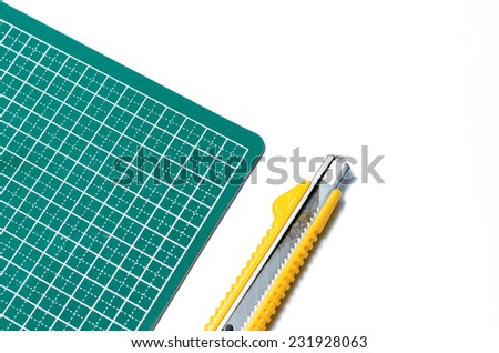 cutter knife on cutting board on a white background