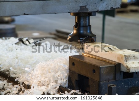 Cutters milling machine with scrap in factory - stock photo