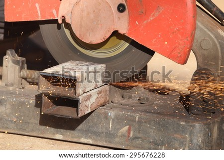 cutting a metal and steel with compound mitre saw with sharp, circular blade - stock photo