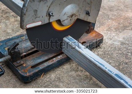 Cutting a square metal and steel with compound mitre saw with circular blade