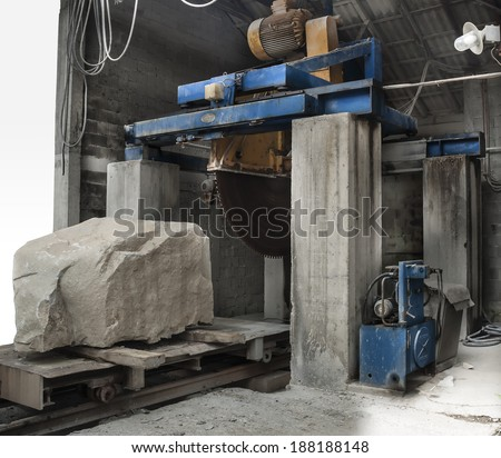 cutting a stone with a circular saw, motion blur on saw and cooling water. The modern cutting line in stone saw mill