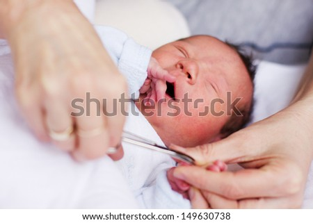 Cutting baby nails . - stock photo