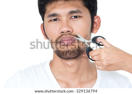 Cutting beard of young man, Isolate on white background, in studio, close up