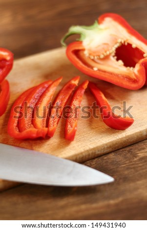 Cutting Bell Pepper. Series - making tortilla with chicken and bell pepper. - stock photo