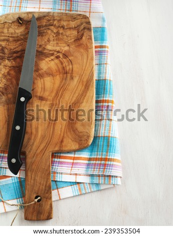 Cutting board and knife - stock photo