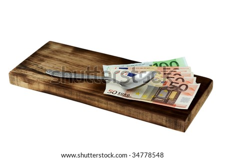Cutting board and money.