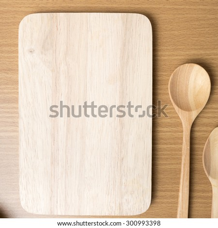 cutting board and wooden spoon on table