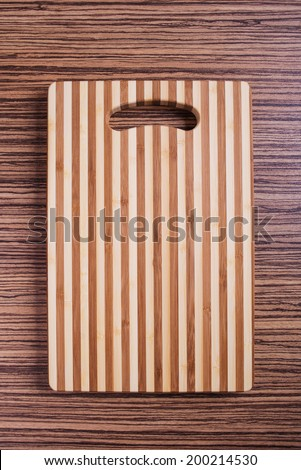 cutting board on a wood background