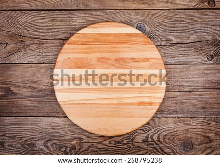 cutting board on old table - stock photo