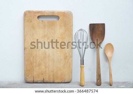 cutting board on on a old wooden table - stock photo