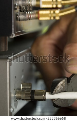 Cutting Cable TV Cable - stock photo