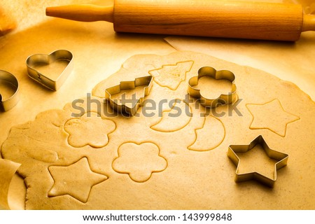 Cutting Christmas cookies made of gingerbread