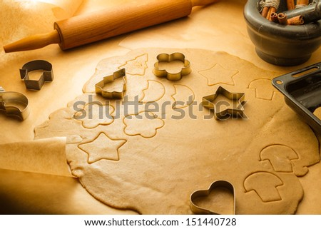 Cutting Christmas cookies made �¢??�¢??of gingerbread