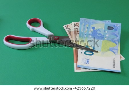 Cutting costs - stock photo