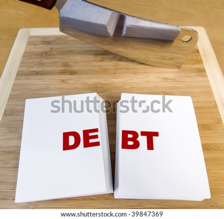 Cutting debt with a cleaver and cutting board.