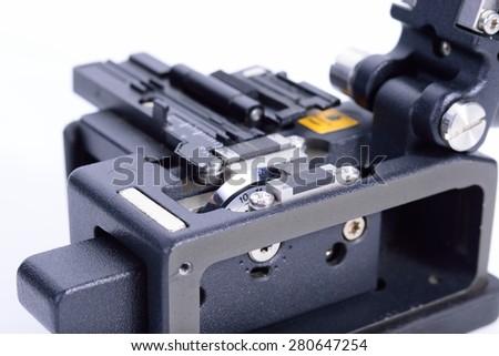 Cutting fiber optic cable. - stock photo