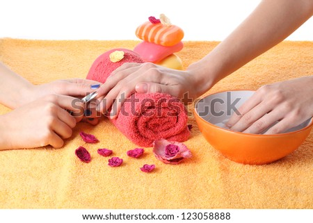 Cutting fingernails before doing french manicure - stock photo