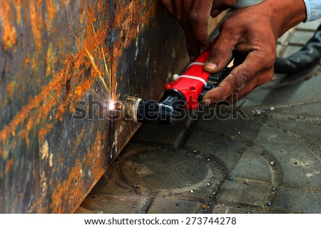 Cutting  large steel  with  Plasma cutters. - stock photo