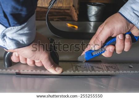 Cutting leather handmade. Bulgaria, Plovdiv - stock photo