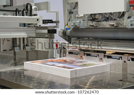 Cutting machine in a print shop - stock photo
