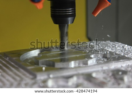Cutting metal modern processing technology. Small depth of field. Warning - authentic shooting in challenging conditions. A little bit grain and maybe blurred. - stock photo