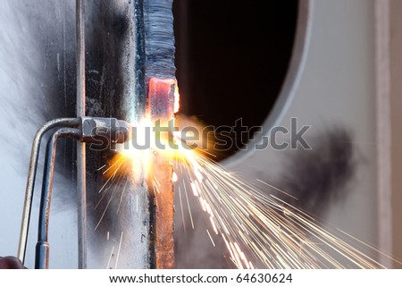 cutting metal using acetylene torch - stock photo