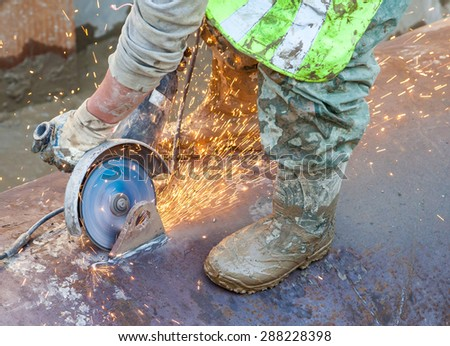 Cutting metal with angle grinder and a lot of sparks - stock photo