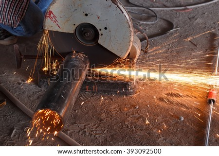 Cutting of a steel with splashes of sparks at construction site. - stock photo