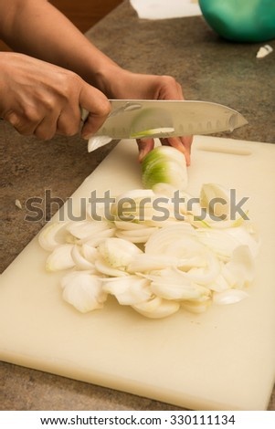 Cutting of onions to be used in canning pickles.