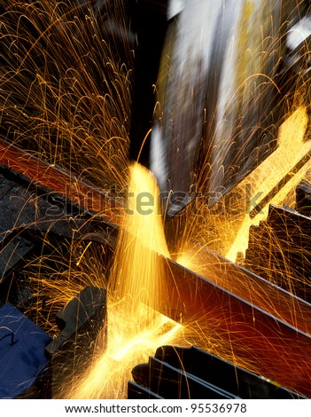 Cutting of steel rod. - stock photo